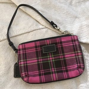 Coach pink and black wristlet